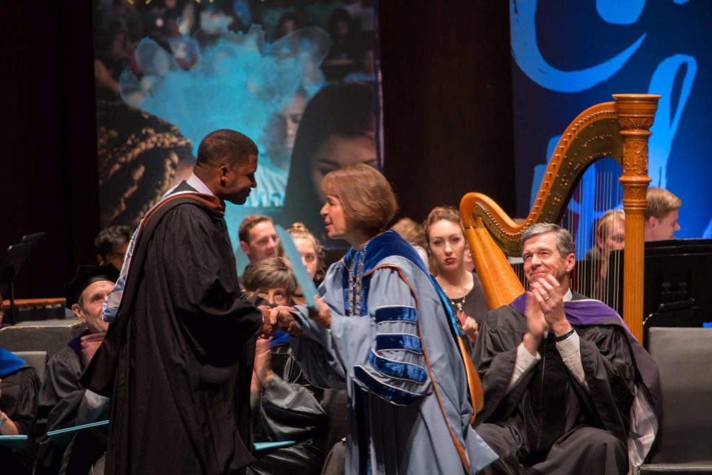 Mike Wiley receives Distinguished Alumnus Award from Chancellor Folt. Photo Courtesy UNC-Chapel Hill College of Arts & Sciences.