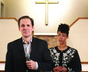 Joey Collins and Nemuna Ceesay as Pastor Paul and his wife Elizabeth.
