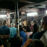 Producing Associate Alejandro Rodriguez leads visitors on a backstage tour to the trap room under the stage