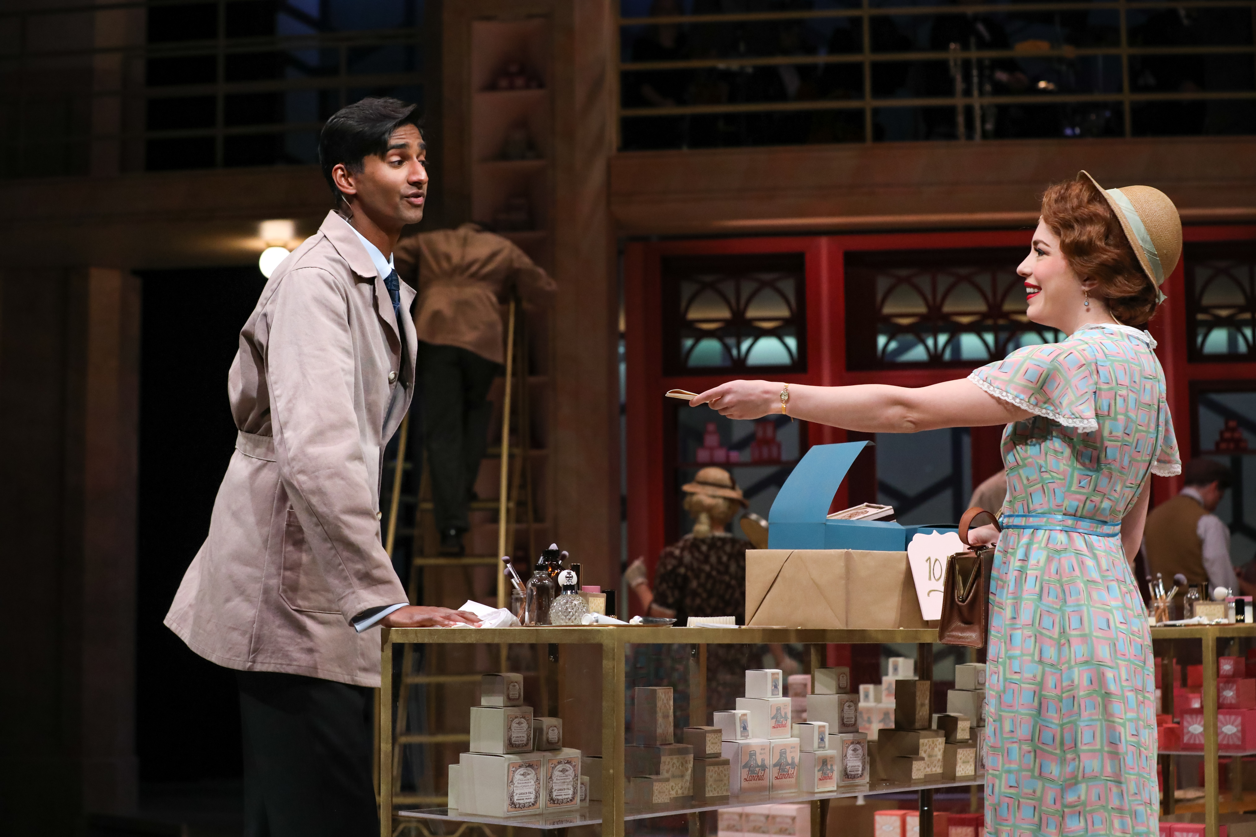 Michael Maliakel as Georg and Jenny Latimer as Amalia in PlayMakers Repertory company's production of SHE LOVE ME. Directed by Kirsten Sanderson. Costume design by Bobbi Owen.