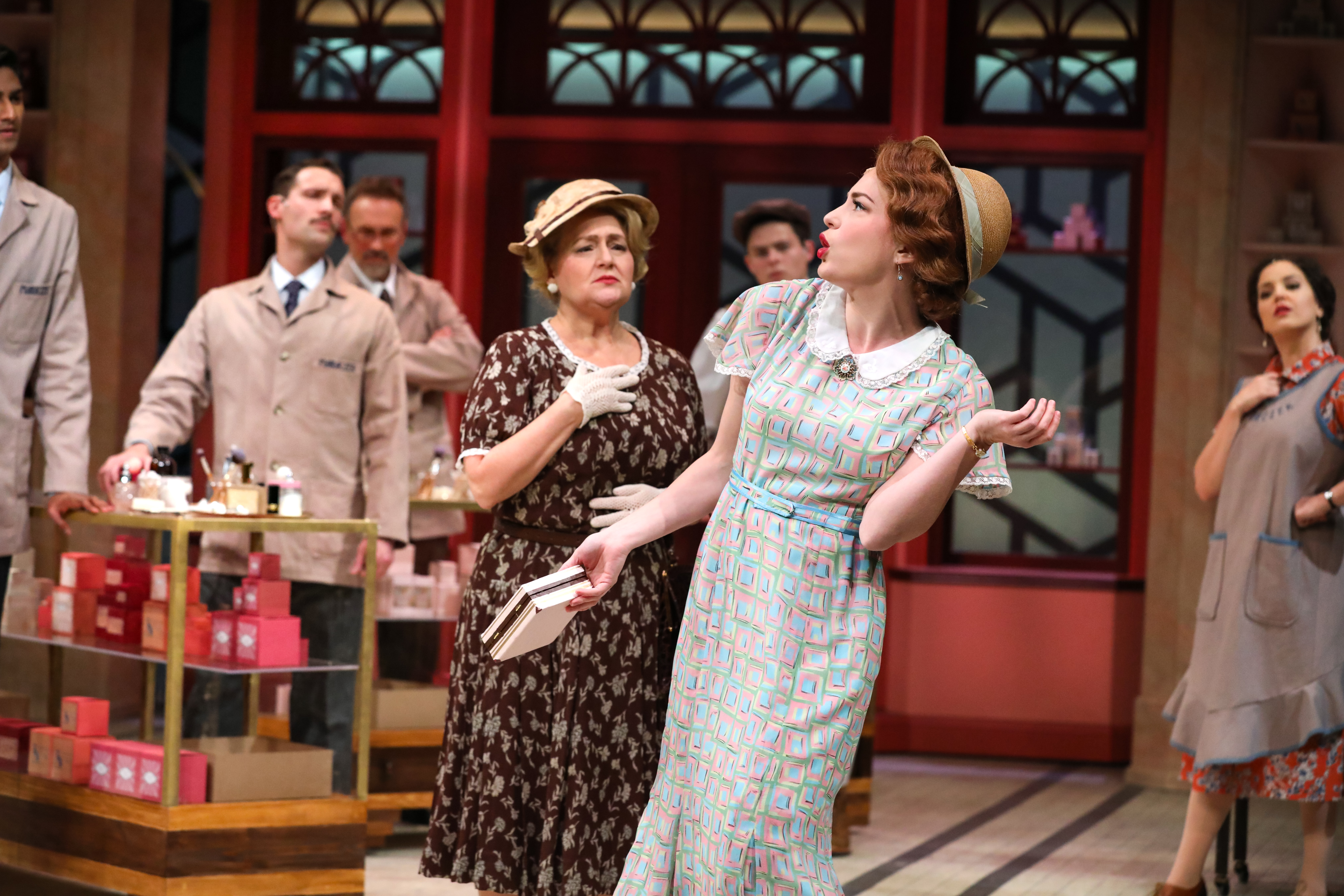Jenny Latimer as Amalia with Julia Gibson and the cast of PlayMakers' 'She Loves Me.' Directed by Kirsten Sanderson. Costume design by Bobbi Owen. (HuthPhoto)