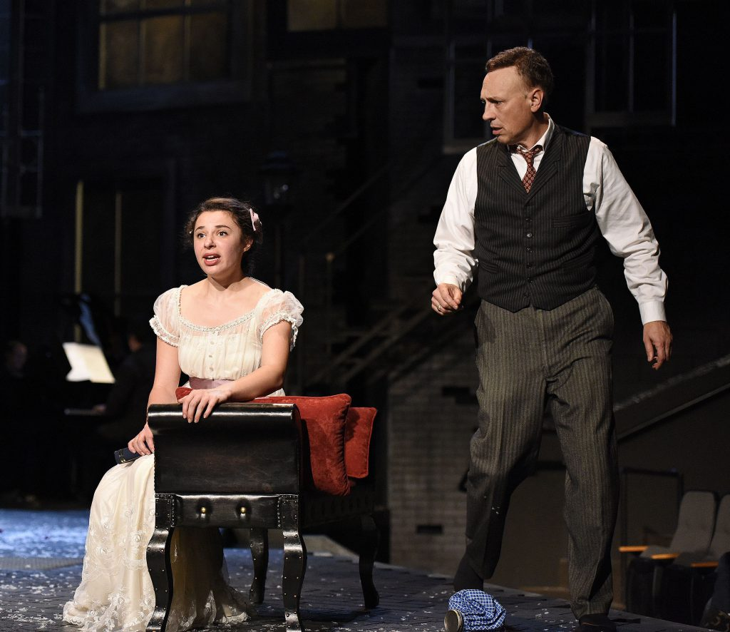 In PlayMakers' 2017 production of 'My Fair Lady,' Eliza Doolittle (Mia Pinero) discovers the power of language to give her agency, as her teacher, Henry Higgins (Jefrey Blair Cornell), looks on gobsmacked. Photo by HuthPhoto