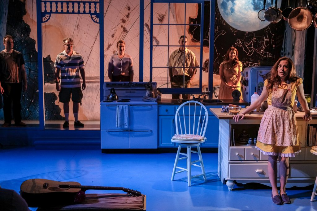 Pictured: Claire Karpen, with Dani Cochrane, and Brian Ogden in the Detroit Public Theatre premiere of BIRTHDAY CANDLES by Noah Haidle. Scenic design by Michael Carnahan, lighting design by Cecilia R Durbin, and costume design byr Shelby Newport.