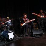 Brevan Hampden, drums; Russell Favret, guitar; Christian Sharp, bass. Directed by Kathryn Hunter-Williams.