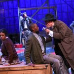 "April Mae Davis as Bessie, Brandon Herman St. Clair Haynes as Bigger Thomas, and Daniel P. Wilson as Britten with Brandon J. Pierce as The Black Rat in Nambi E. Kelley's ""Native Son"" at PlayMakers Repertory Company. (HuthPhoto)"